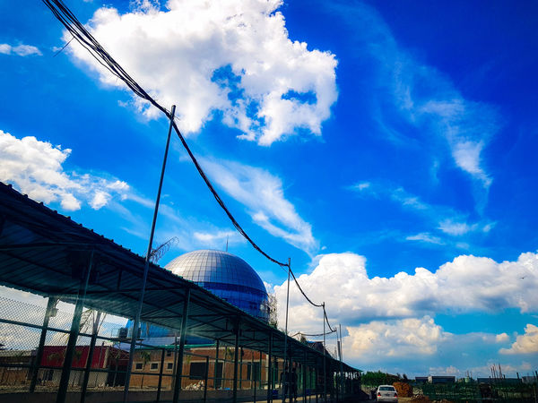 Drive way to New AIUB campus !! Cloud - Sky Sky Outdoors No People Blue Low Angle View Built Structure Architecture City Nature Drive Way While Driving Motion Capture My Smartphone Life S8Photography Full Length AIUBians Under Construction... Architectural Feature The Street Photographer - 2017 EyeEm Awards AIUB Arts Culture And Entertainment Scenics Dramatic Sky Nature EyeEmNewHere Discover Berlin The Week On EyeEm Paint The Town Yellow Been There. Done That. Lost In The Landscape