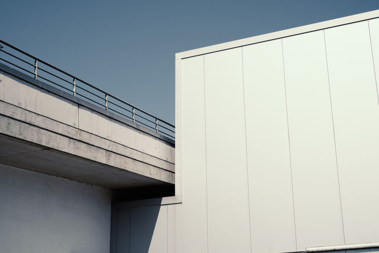 PARKING AREA EAST Wall - Building Feature Architecture Built Structure Building Exterior No People White Color Day Outdoors City Low Angle View Sky Clear Sky Nature Modern Building Copy Space Sunlight Office Building Exterior Pattern Office Concrete