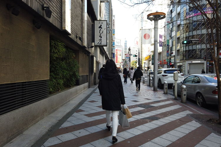 Urban Winter Street City Shibuya Tokyo Japan Architecture Building Exterior Built Structure Walking Real People Lifestyles Transportation Footpath Rear View Women People Motor Vehicle Full Length City Life Car Adult Road Outdoors