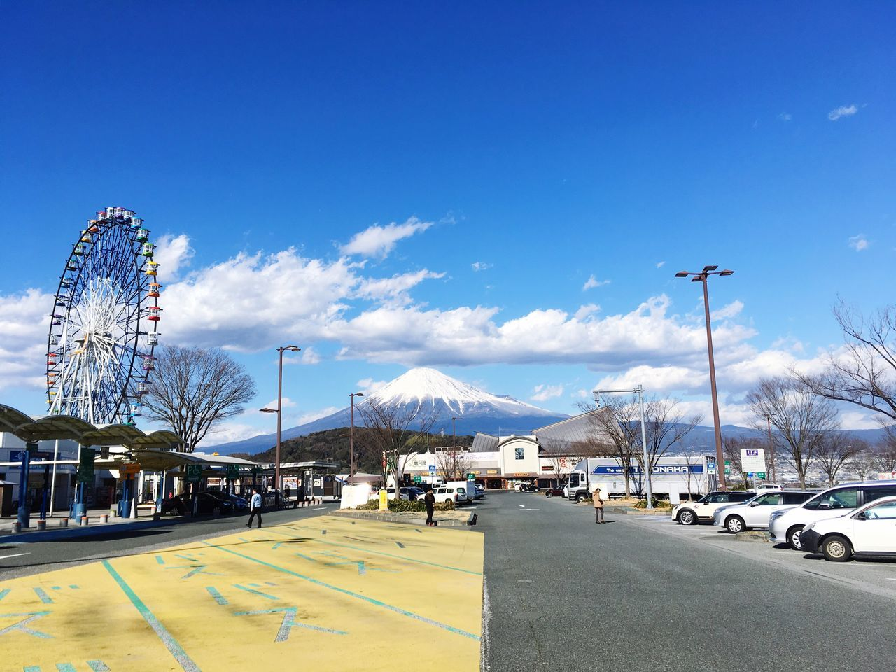 sky, blue, day, amusement park, outdoors, road, car, transportation, cloud - sky, bare tree, no people, snow, tree, nature