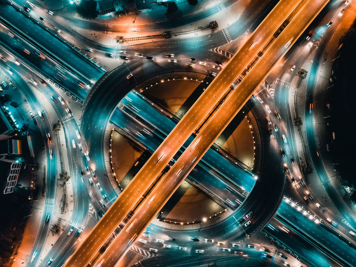 Aerial view of illuminated highways in city
