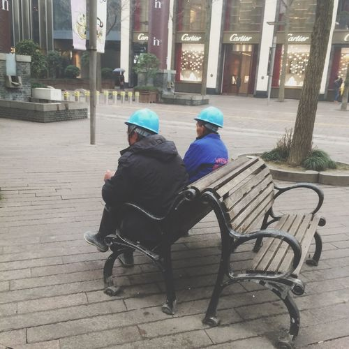 blue hats Full Length Sitting Togetherness Childhood Lifestyles City Bonding Leisure Activity Son Transportation Architecture Family With One Child Father Casual Clothing City Life Building Exterior Roadside Day Relaxation