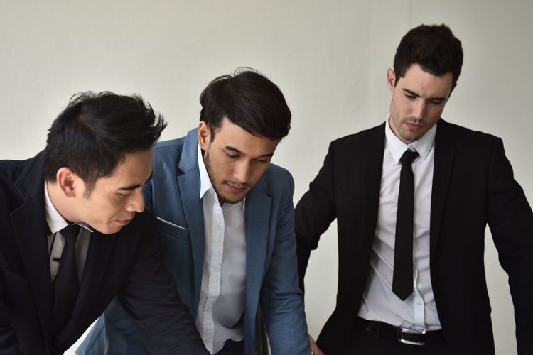Young Men Young Adult Well-dressed Business Person Indoors  Group Of People Suit Men Formalwear Businessman Business Togetherness Front View People Waist Up Occupation Cooperation Colleague Teamwork Coworker