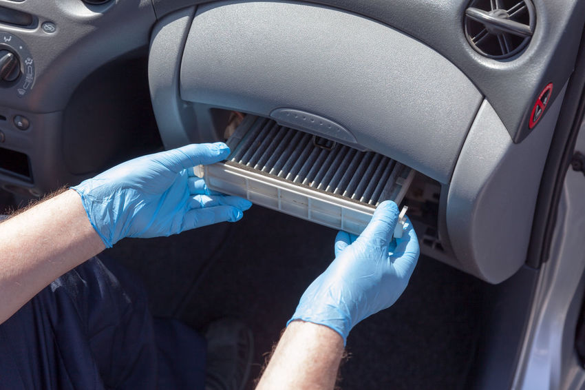 Replacing the car cabin air filter Automobile Care Mechanic Transportation Air Filter Automotive Automotive Cabin Air Filter Cabin Air Filter Car Car Air Conditioning Car Air Filter Car Service Car Spare Parts Change Dust Health Human Hand Maintenance Pollen Protective Glove Replacing Vehicle Ventilation Working