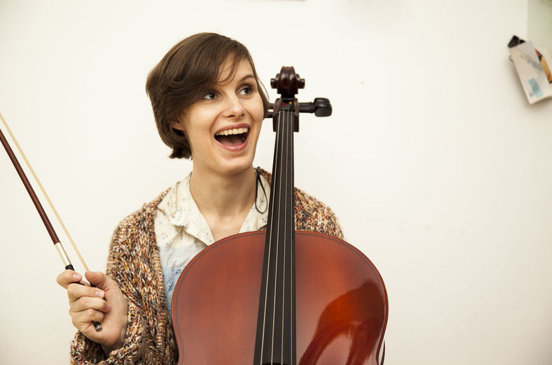 Cheerful woman playing violin