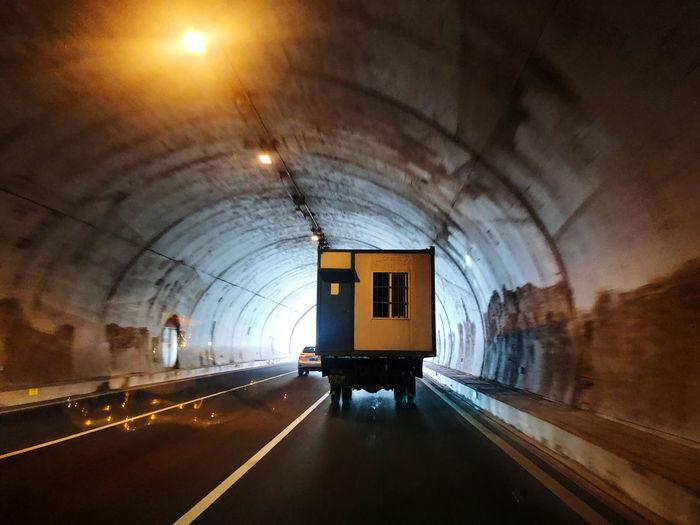 Train in illuminated tunnel