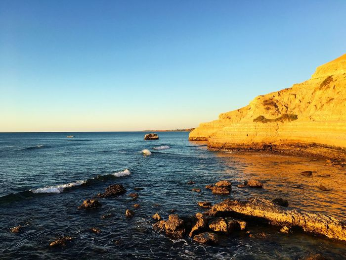 Sea Water Clear Sky Scenics Horizon Over Water Beauty In Nature Blue Nature Rock - Object Tranquil Scene Cliff Tranquility Outdoors Beach No People Day Sky