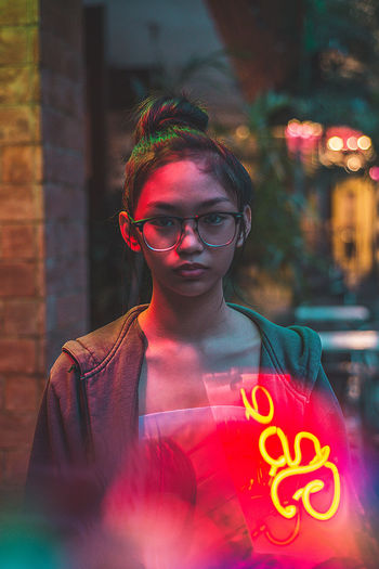 Eyeem Philippines The Week On EyeEm Beautiful Woman Building Exterior Casual Clothing City Lights Close-up Communication Day Eyeglasses  Front View Illuminated Mid Adult Neon Neon Lights One Person Outdoors People Portraiture Real People Red Street Lights Street Photography Text Young Adult Young Women Fresh on Market 2017 Rethink Things Step It Up Capture Tomorrow