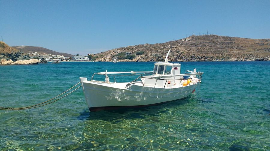 fishing boat floating on clear waves Boat Trip Fisherman Boat Small Boat Greece Syros Syros Island Sea Clear Sea Sea Watercolour Sea Water