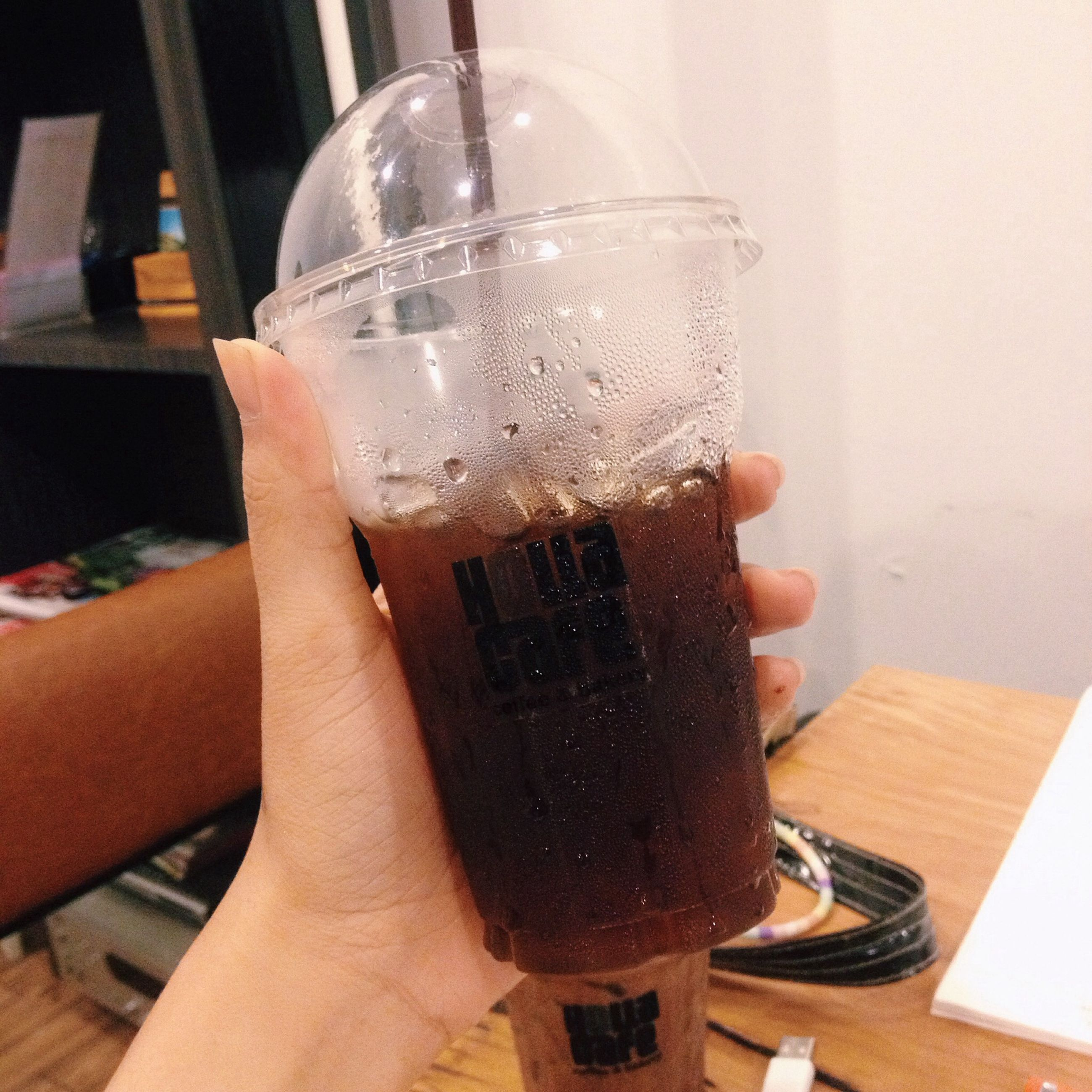 drink, food and drink, refreshment, indoors, table, person, drinking glass, freshness, holding, alcohol, lifestyles, part of, coffee - drink, coffee cup, cropped, close-up, leisure activity