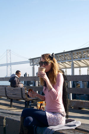 Architecture Blue Bridge - Man Made Structure Built Structure Casual Clothing City City Life Clear Sky Connection Day Full Length Holding Leisure Activity Lifestyles Long Hair Outdoors People And Places Person San Francisco Side View Sitting Transportation Young Adult Young Women TK Maxx Socksie Always Be Cozy