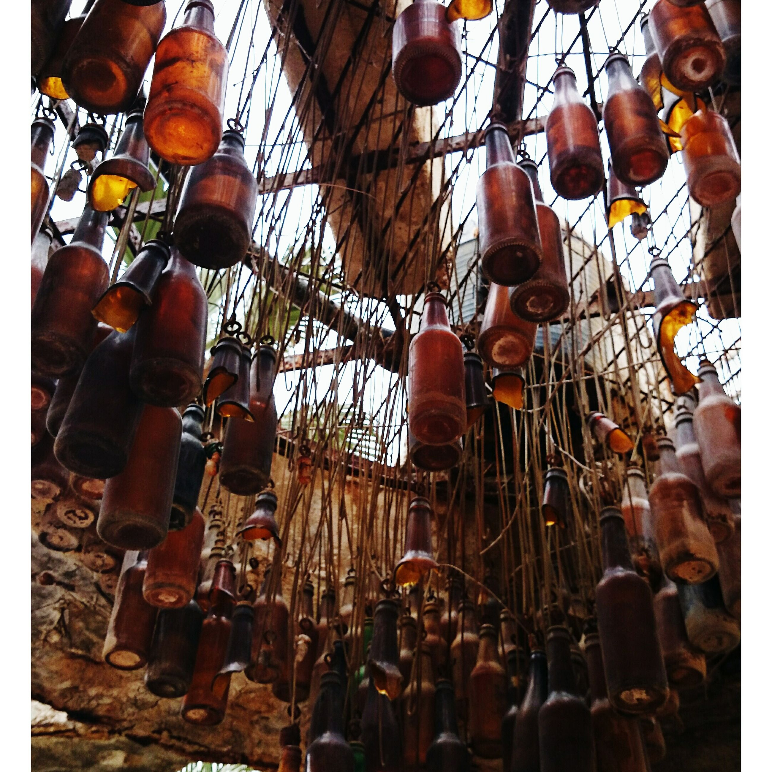 metal, abundance, hanging, large group of objects, low angle view, metallic, in a row, padlock, day, close-up, outdoors, industry, variation, rusty, cultures, equipment, no people, wood - material, protection
