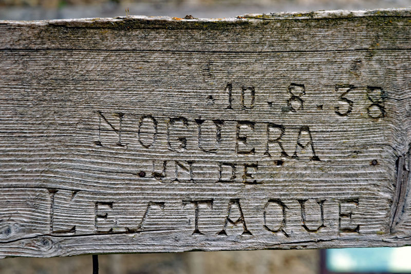 Close-up of text on wood