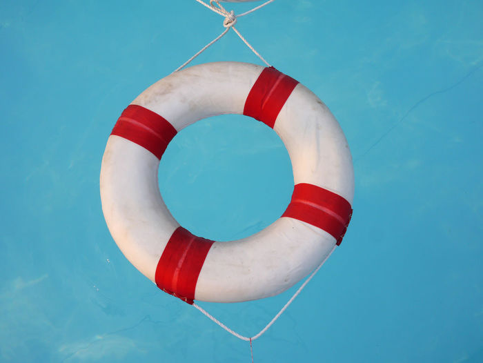 Lifebuoy Blue Buoy Clear Sky Close-up Day Hanging Life Belt Nature No People Outdoors Red Rescue Sky Swimming Pool Water