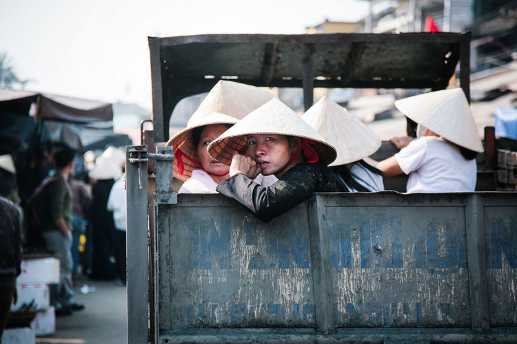 Hoi An, Vietnam Central Vietnam Communication Commuting Extras Group Of People Hoian  Hoian, Vietnam Leaf Hat Looking At Camera Movie Extras Movie Set Nonla Old Town Old Truck On The Road People Portrait South East Asia Street Photography Streetphoto Streetphotography Travel Photography Truck Vietnam Workers The Week On EyeEm Editor's Picks