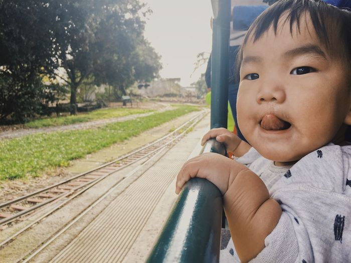 Close-up of cute baby boy on train