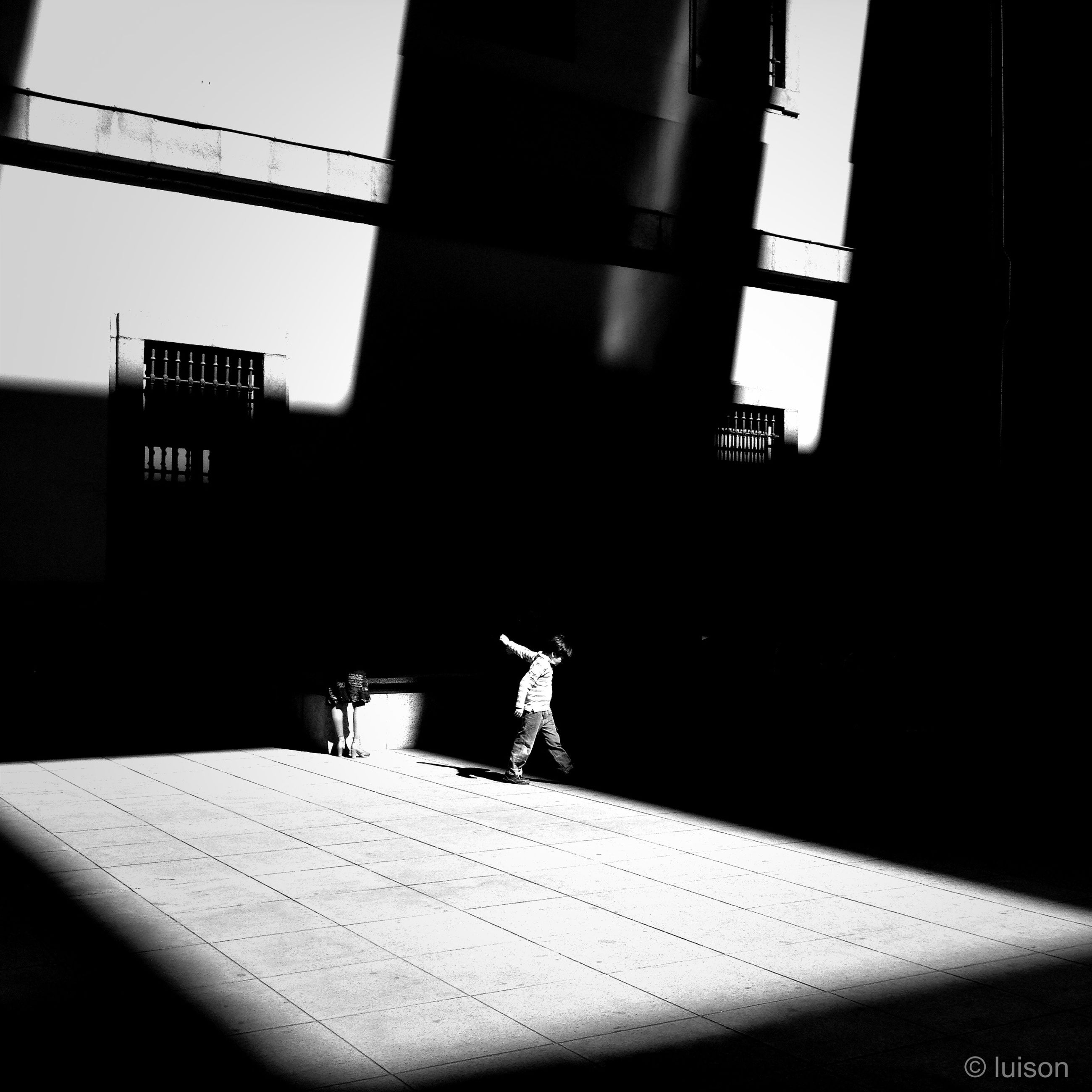 indoors, architecture, built structure, lifestyles, shadow, full length, silhouette, window, men, building exterior, person, leisure activity, wall - building feature, standing, walking, sunlight, wall, day