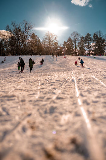 Group of people on snow covered field