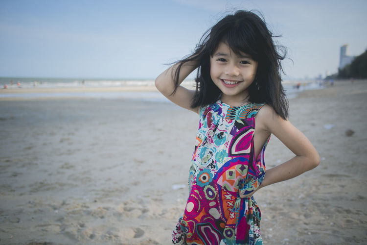 Portrait little girl at the beach Beach Looking At Camera Land Portrait Smiling One Person Sea Childhood Emotion Happiness Real People Leisure Activity Sand Females Lifestyles Water Women Casual Clothing Child Hair Innocence Hairstyle Outdoors