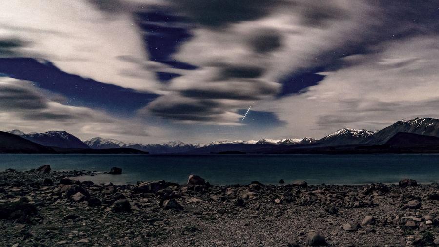 Shooting Star at Lake Tekapo   New Zealand Beauty In Nature Cloud - Sky Clouds Lake Lake Tekapo Lake View Long Exposure Meteoroid Mountain Nature Night Night Photography Nightphotography No People Outdoors Shooting Star Sky Water