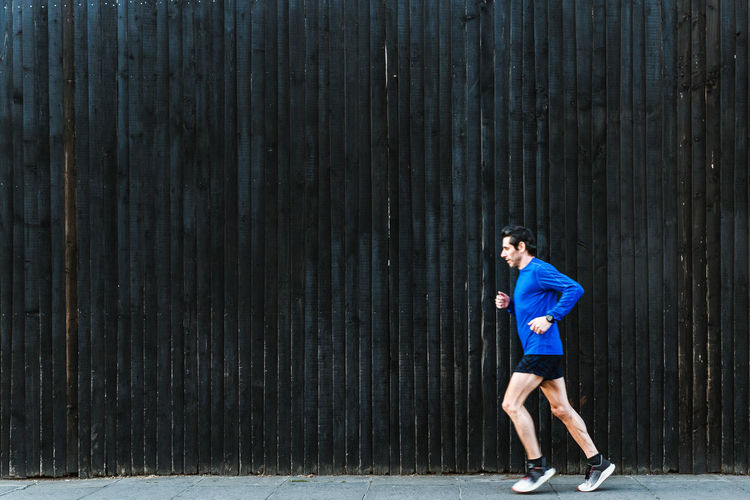Full length of a boy running