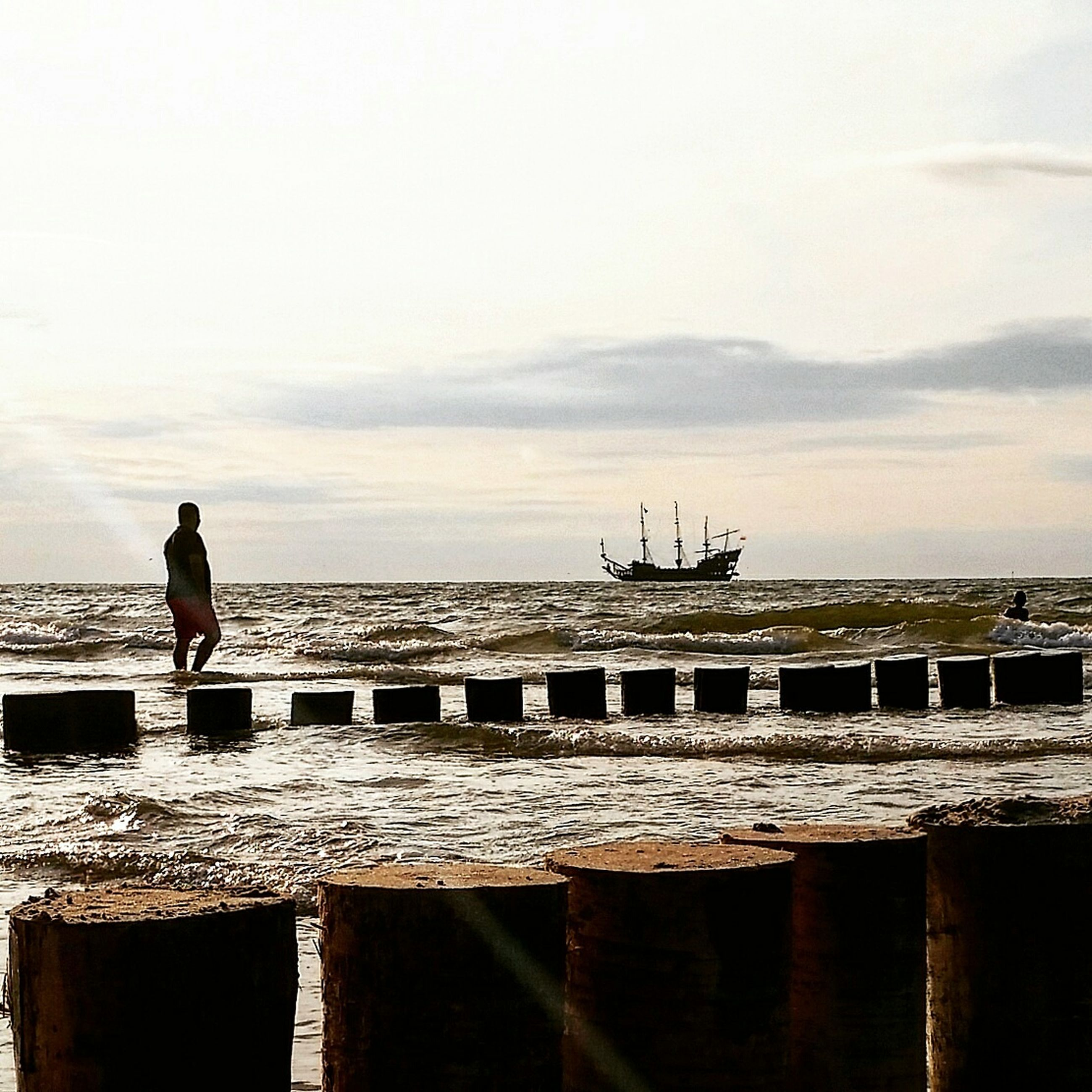 water, sea, sky, silhouette, pier, full length, cloud, tranquility, jetty, tranquil scene, cloud - sky, nature, outdoors, day, scenics, seascape, ocean, beauty in nature, promenade