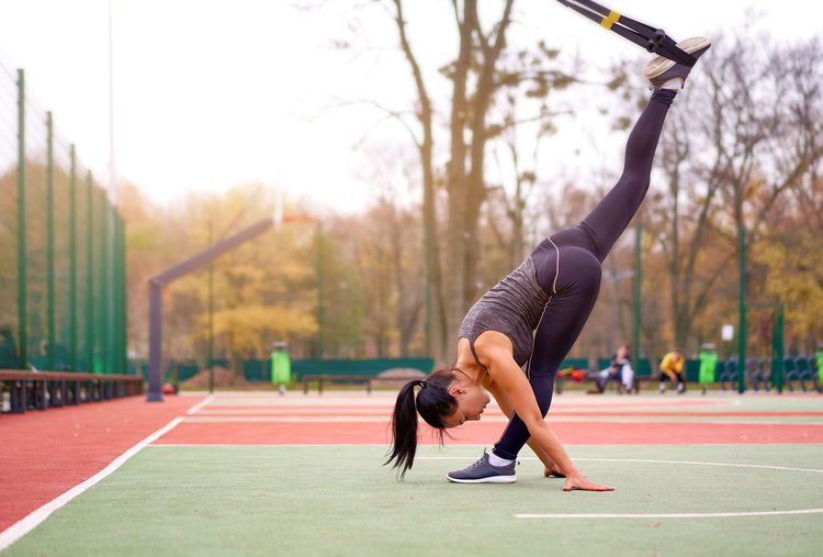 Woman exercising on sports court