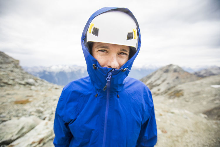 Portrait of boy wearing sunglasses against mountains