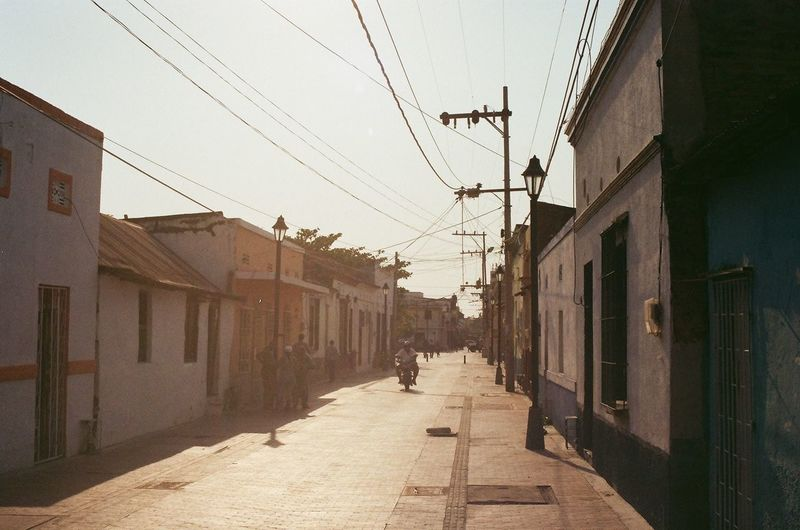 Santa Marta Analogue Photography Canont70 Film Photography Nofilter EyeEmNewHere Sun Colombia City Cable Sky Architecture Building Exterior Built Structure Telephone Line Electricity Tower Diminishing Perspective Empty Road