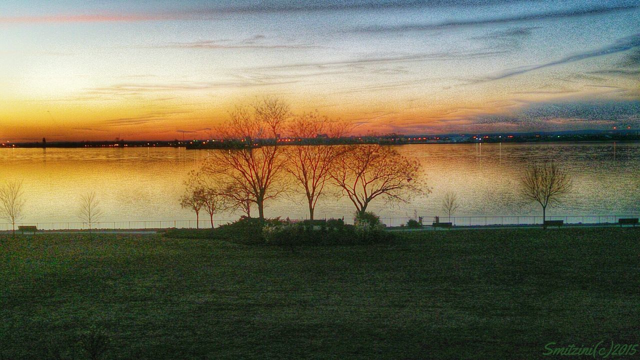 sunset, beauty in nature, nature, scenics, water, tranquil scene, reflection, tranquility, sky, grass, lake, idyllic, orange color, no people, cloud - sky, outdoors, tree, landscape, day