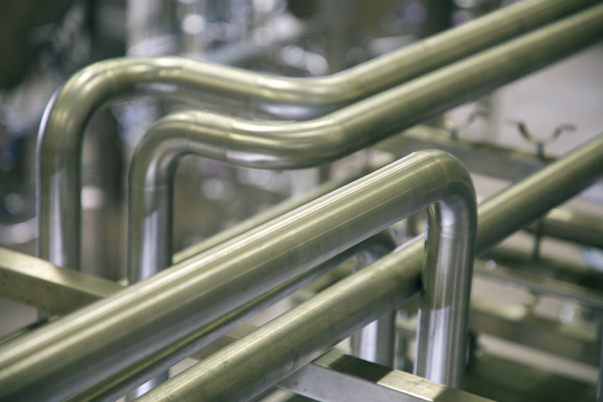crossing pipes Fluids High Pressure Inanimate Industry Objects Beauty Close-up Cold Electric Light Factory Focus On Foreground Inanimate Objects Metal Metallic Neon Lights No People Selective Focus Silence Stainless Steel
