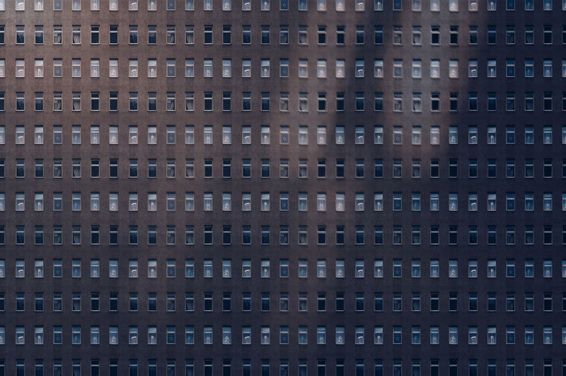 Architectural pattern, reflected light on a facade of a miserable house, with blur effekt
