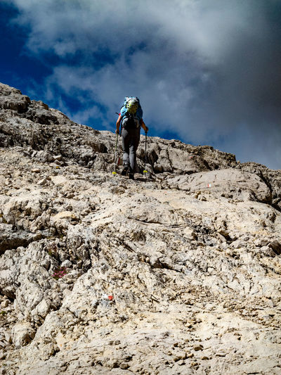 Dolomites, Italy Adventure Backpack Beauty In Nature Cloud - Sky Day Full Length Hiker Hiking Leisure Activity Lifestyles Low Angle View Men Mountain Nature One Person Outdoors People Real People Rock - Object Sky