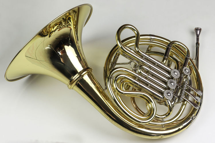 Music Instrument French horn Studio Shot Musical Instrument Metal Music Arts Culture And Entertainment White Background Indoors  Gold Colored Brass Instrument  Still Life Cut Out Close-up Musical Equipment No People Single Object Wind Instrument Brass Trumpet Shiny Silver Colored