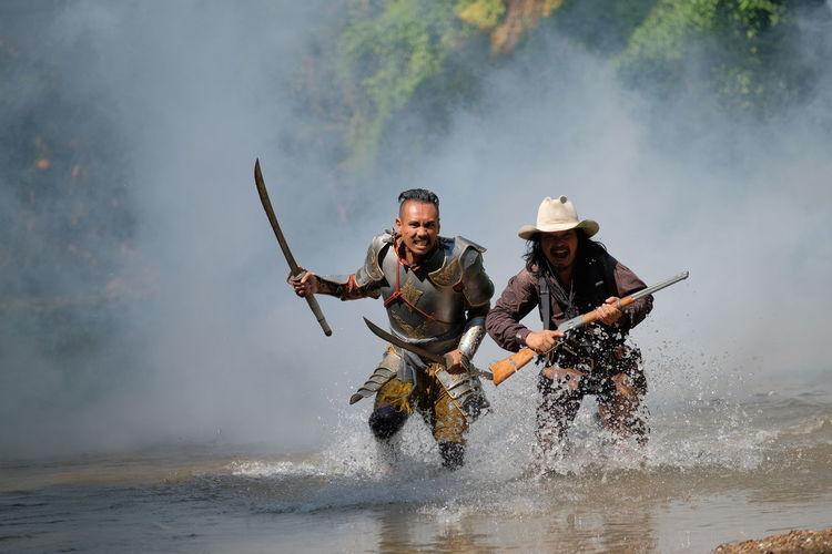Full length of men on water