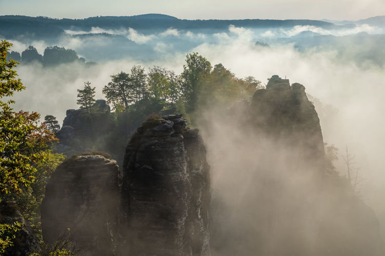 Scenic view of rock formation amidst fog