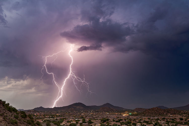 Lightning strikes from a monsoon thunderstorm near Phoenix, Arizona. Arizona Ethereal Storm Beauty In Nature Cloud - Sky Danger Dramatic Sky Electricity  Extreme Weather Forked Lightning Illuminated Landscape Lightning Lightning Bolt Mountain Nature Outdoors Phoenix Power In Nature Scenics Sky Storm Storm Cloud Thunderstorm Weather