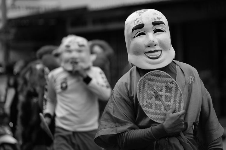 Close-up of man wearing mask during event