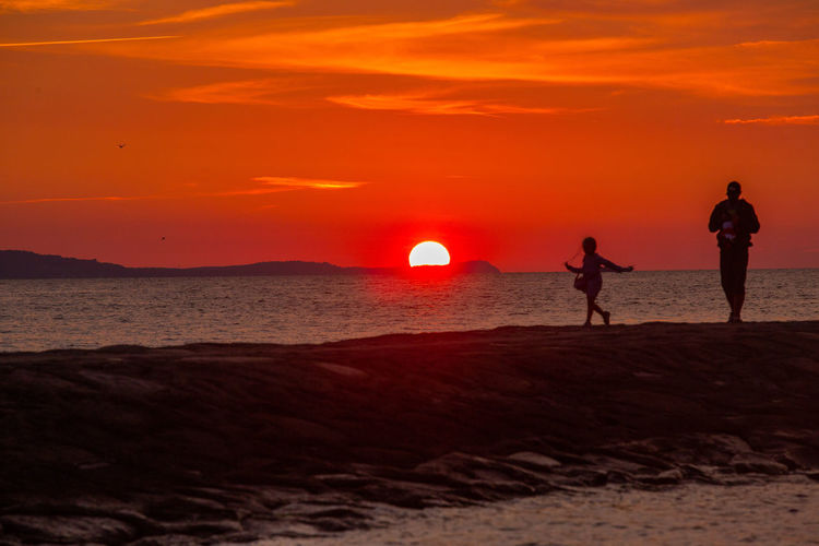 Baltic Sea Stawa Mlyny Beach Beauty In Nature Horizon Over Water Land Leisure Activity Men Nature Orange Color Outdoors People Real People Scenics - Nature Sea Silhouette Sky Standing Sun Sunset Togetherness Two People Water