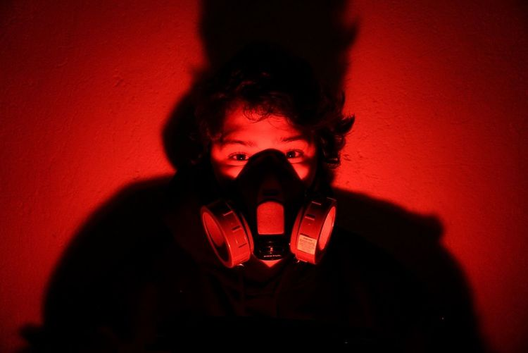 crazy for this times Technology Wireless Technology Red Studio Shot Computer Crime Spooky Futuristic Spy Burglary Cellphone Murderer Film Noir Style Red Background Gas Mask Peeking