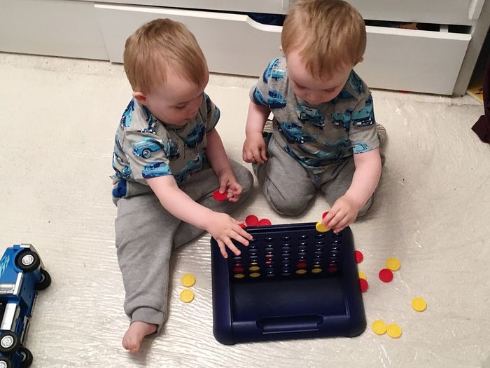 EyeEm Selects Baby Two People Learning Childhood Toddler  Boys Indoors  Playing Real People Togetherness Day Full Length Blond Hair People Adult Indenical Twins Playing Games Sharing  Playing Together Learning Through Play Sommergefühle