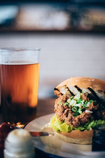 Close-Up Of Burger And Iced Tea On Table