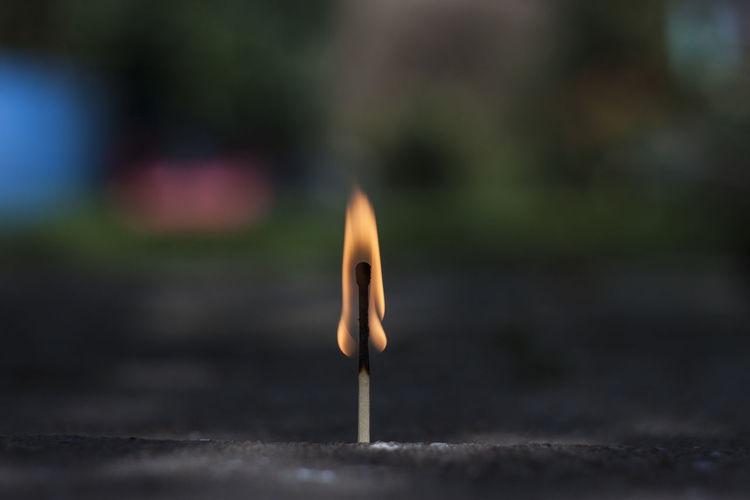 Close-up of burning matchstick