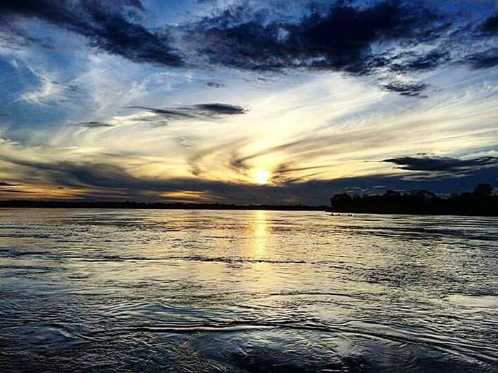 Rio Guaviare Sunset Cloud - Sky Dramatic Sky Sea Scenics Water Nature Landscape No People Reflection Outdoors Beauty In Nature Sky Blue Sun Tranquil Scene Sunlight Beauty Travel Destinations Horizon Over Water