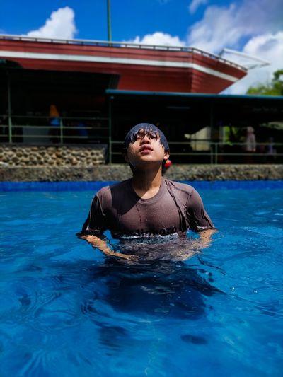 Portrait of man swimming in pool