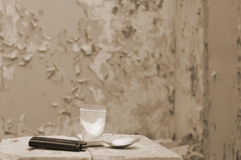 Close-up of ice cream on table against wall