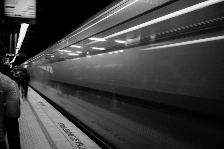 Stand behind the yellow line Blackandwhite Long Exposure Monochrome Photography Platform Public Transportation Subway Subway Station Subwayphotography Train Train Station Travel Capturing Movement The City Light
