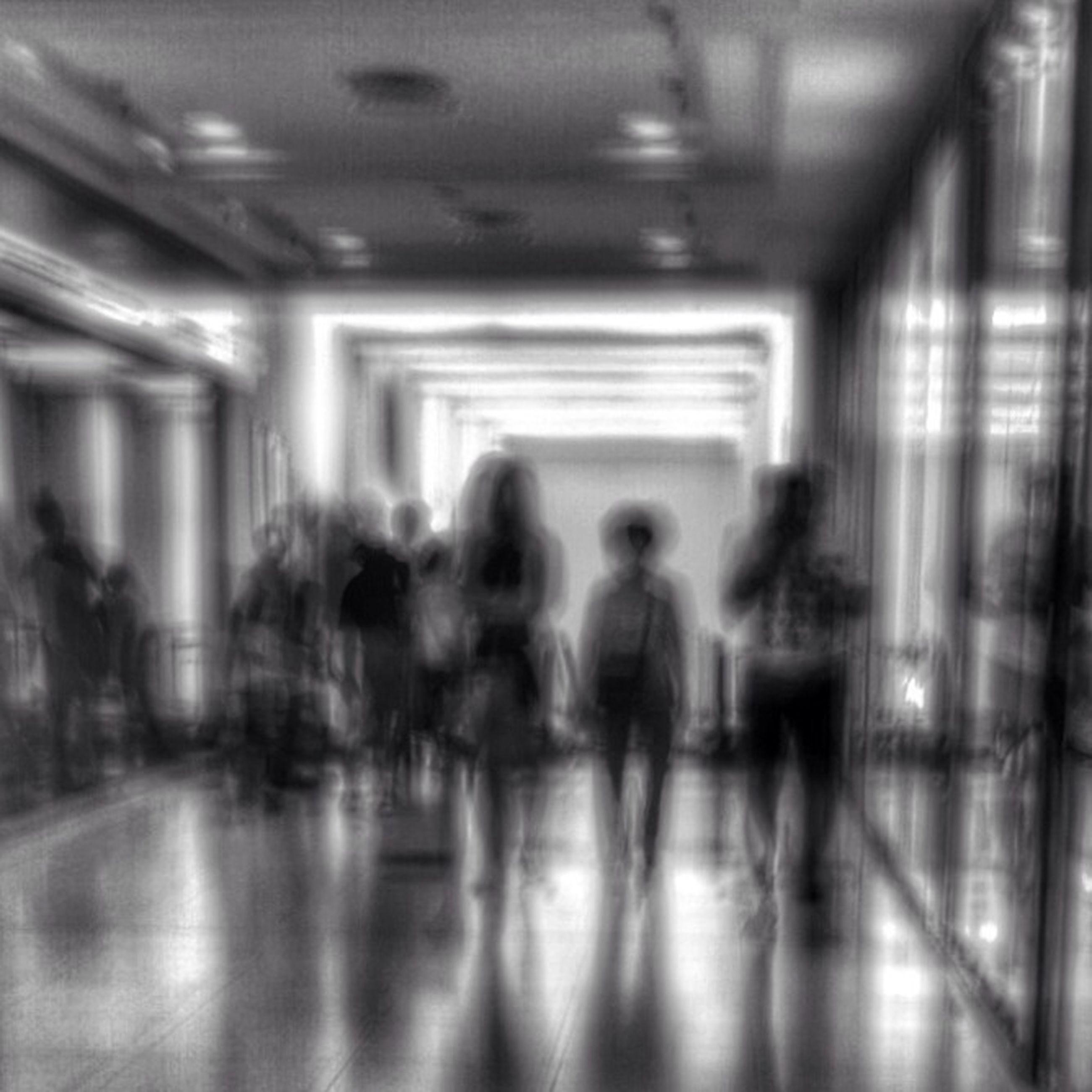 indoors, men, lifestyles, person, public transportation, walking, illuminated, transportation, passenger, subway station, leisure activity, subway, blurred motion, ceiling, railroad station, travel, medium group of people, corridor, large group of people