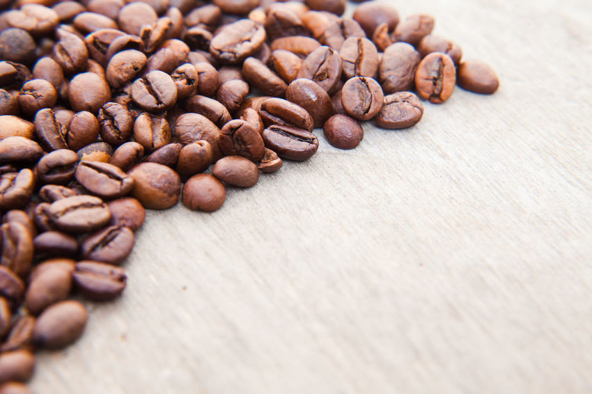 Fine roasted coffee beans on wooden background Background Coffee Coffee Beans Coffee Break Coffee Crop Coffee Culture Coffee Growing Coffee Time Copy Space Fair Trade Roasted Coffee Bean Text Space Textures And Surfaces Wooden Background