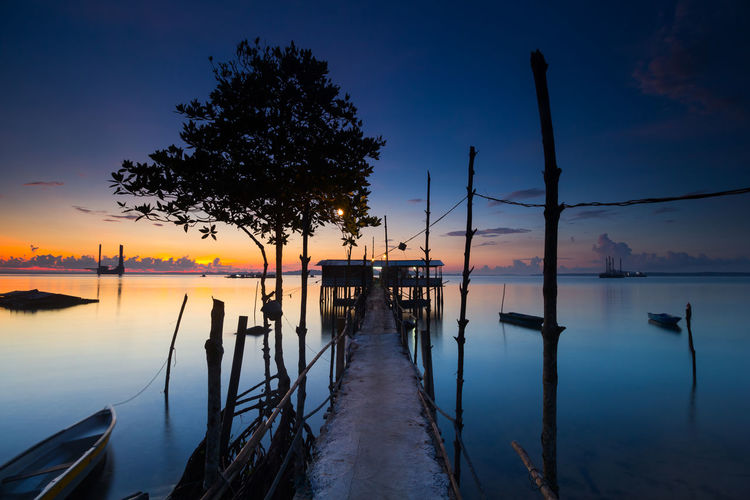 Beauty In Nature Nature Nautical Vessel No People Outdoors Reflection Scenics - Nature Sky Sunset Tranquil Scene Tranquility Transportation Water Wooden Post